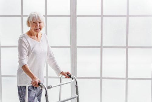 visitability home Smiling retiree holding walker