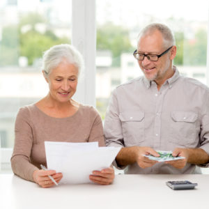 senior couple with money ageing in place