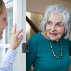 Woman Checking On Elderly Female Neighbor age in place