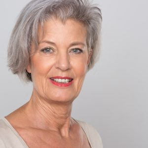 Smiling senior woman aging alone