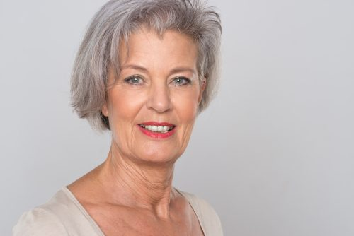 Smiling senior woman aging alone